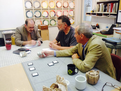 Turk (far right) working with the Homer Laughlin China Company to replicate the original mug